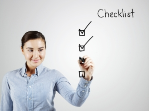 iStock_000018416955Medium Girl ticking checklist