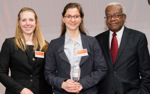 Celine receiving her award from Sir Trevor McDonald and Joanne Normans Programmes Team Leader from EDF Energy