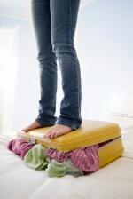 iStock_000008639225XLarge Standing on suitcase