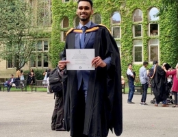 Male graduate with a degree certificate