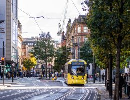 Manchester street with tram and people